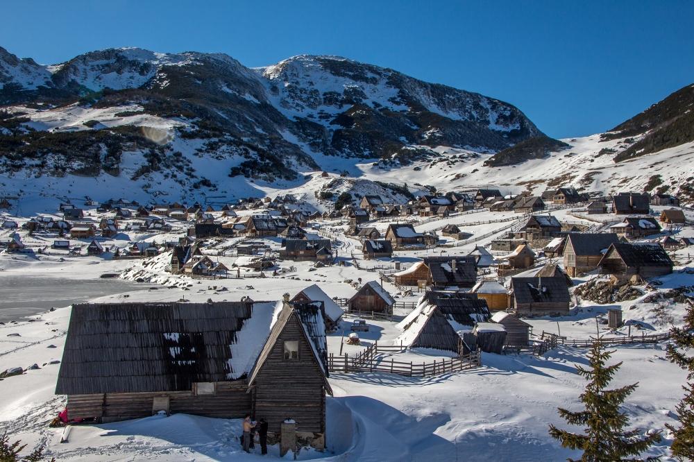 Cabins-near-frozen-lake