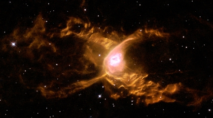 Huge waves are sculpted in this two-lobed nebula some 3000 light-years away in the constellation of Sagittarius. This warm planetary nebula harbours one of the hottest stars known and its powerful stellar winds generate waves 100 billion kilometres high. The waves are caused by supersonic shocks, formed when the local gas is compressed and heated in front of the rapidly expanding lobes. The atoms caught in the shock emit the spectacular radiation seen in this image.