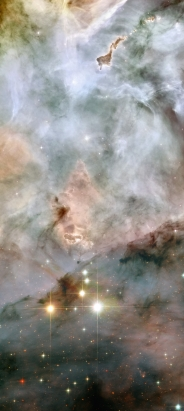 """WR 25 and Tr16-244, at the bottom of the image, are located within the open cluster Trumpler 16. This cluster is embedded within the Carina Nebula, an immense cauldron of gas and dust that lies approximately 7500 light-years from Earth in the constellation of Carina, the Keel. At the top of the image, a peculiar nebula with the shape of a """"defiant"""" finger points towards WR25 and Tr16-244."""