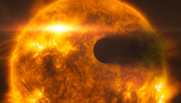This artist's impression shows exoplanet HD 189733b, as it passes in front of its parent star, called HD 189733A. Hubble's instruments observed the system in 2010, and in 2011 following a large flare from the star (depicted in the image). Following the flare, Hubble observed the planet's atmosphere evaporating at a rate of over 1000 tonnes per second.In this picture, the surface of the star, which is around 80% the mass of the Sun, is based on observations of the Sun from the Solar Dynamics Observatory.