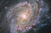 This new Hubble image shows the scatterings of bright stars and thick dust that make up spiral galaxy Messier 83, otherwise known as the Southern Pinwheel Galaxy. One of the largest and closest barred spirals to us, this galaxy is dramatic and mysterious; it has hosted a large number of supernova explosions, and appears to have a double nucleus lurking at its core.