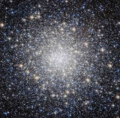 This striking new NASA/ESA Hubble Space Telescope image shows a glittering bauble named Messier 92. Located in the northern constellation of Hercules, this globular cluster — a ball of stars that orbits a galactic core like a satellite — was first discovered by astronomer Johann Elert Bode in 1777. Messier 92 is one of the brightest globular clusters in the Milky Way, and is visible to the naked eye under good observing conditions. It is very tightly packed with stars, containing some 330 000 stars in total. As is characteristic of globular clusters, the predominant elements within Messier 92 are hydrogen and helium, with only traces of others. It is actually what is known as an Oosterhoff type II (OoII) globular cluster, meaning that it belongs to a group of metal-poor clusters — to astronomers, metals are all elements heavier than hydrogen and helium. By exploring the composition of globulars like Messier 92, astronomers can figure out how old these clusters are. As well as being bright, Messier 92 is also old, being one of the oldest star clusters in the Milky Way, with an age almost the same as the age of the Universe. A version of this image was entered into the Hubble's Hidden Treasures image processing competition by contestant Gilles Chapdelaine. Links Gilles Chapdelaine's Hidden Treasures entry on Flickr